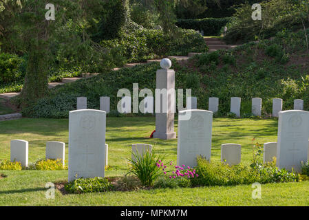 German memorial to the 'Royal' Middlesex Regiment surrounded by a circle of British war graves at St Symphorien Military Cemetery near Mons, Belgium - Stock Photo