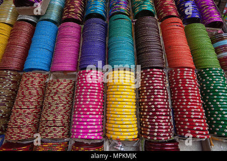 India, West Bengal, Kolkata, Bangles on display in a shop in the Bara Bazar district. - Stock Photo