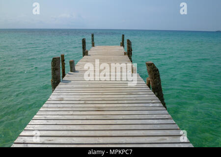 Wooden bridge on the Ao Ngam Kho at Koh Kood island in Thailand - Stock Photo