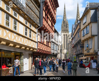 Shops on Rue Kereon looking towards the Cathedral, Quimper, Finistere, Brittany, France - Stock Photo