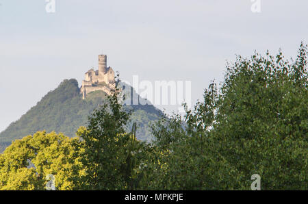 Panoramic view of Bezdez castle in the Czech Republic. In the foreground there are trees, in the background is a hill with castle. - Stock Photo