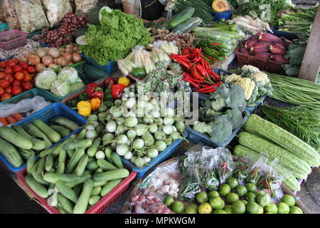 Fruits and vegetables laid out on a market in Thailand - Stock Photo