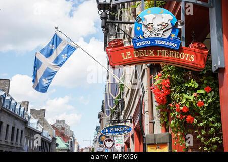 Montreal Canada Vieux Montreal Rue Saint Paul Le Dux Pierrots restaurant flag historic building business sign - Stock Photo