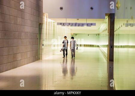 Montreal Canada RESO Underground City tunnel complex world's largest connects 60 buildings Asian male teens - Stock Photo