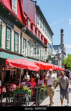 Quebec City Canada Upper Town Rue Sainte Anne Le Relais De La Place D'armes restaurant men walk hands in pockets - Stock Photo