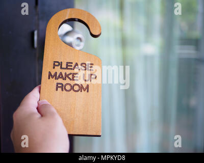 Signboard make up room hanging on open door in a hotel - Stock Photo