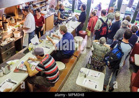 Quebec City Canada Lower Town Rue Saint Paul Buffet de L'Antiquaire diner restaurant counter customers - Stock Photo