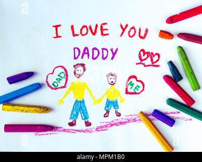Kid drawing of father holding his child for happy father's day theme with I LOVE YOU DADDY message. - Stock Photo