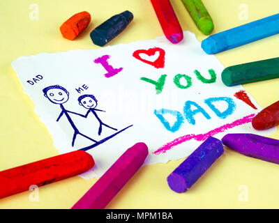Kid drawing of father holding his child for happy father's day theme with I LOVE YOU DADD message. - Stock Photo