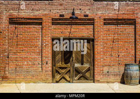Two Wooden Doors To Wine Storage Building - Stock Photo
