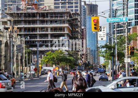 Toronto Canada Ontario Bay Street construction economic development street scene traffic crossing red light pedestrian construct - Stock Photo