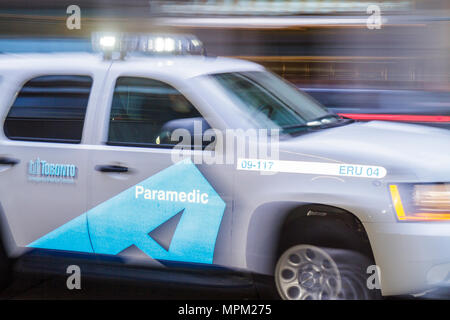 MOTION Toronto Canada Ontario Yonge Street paramedic ambulance medical emergency first responder car flashing lights motion - Stock Photo