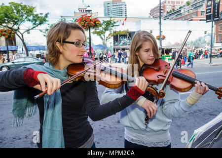 Toronto Canada Ontario St. Lawrence Market shopping entertainment performer woman girl teen young adult violin musical instrumen - Stock Photo