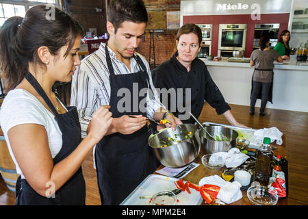 Toronto Canada Ontario St. Lawrence Market shopping Miele kitchen cooking class chef student man woman young adult couple food p - Stock Photo