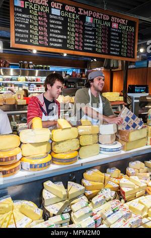 Toronto Canada Ontario St. Lawrence Market shopping vendor merchant cheese shop blackboard special counter man woman sales clerk - Stock Photo