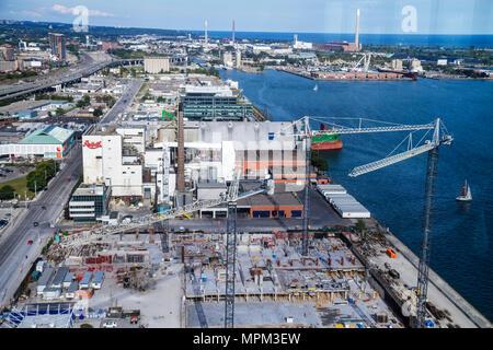 Toronto Canada Ontario Queen's Quay East economic development Redpath Sugar Refinery beyond harbourfront Lake Ontario Waterfront - Stock Photo