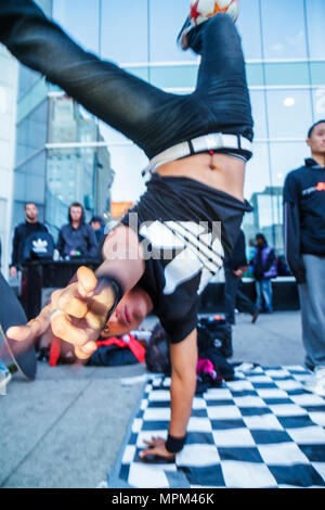 Toronto Canada Ontario Yonge Street MOTION Dundas Square Toronto's Time Square public plaza performer B-boy breakdancing dancer - Stock Photo