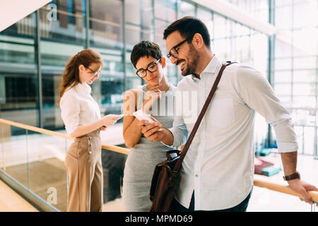 Picture of handsome businessman and beautiful businesswoman - Stock Photo