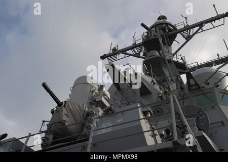 170404-N-ZE250-056   ATLANTIC OCEAN- (April 4, 2017) - The close-in weapons system and superstructure aboard USS Carney (DDG 64) while on patrol in the Atlantic Ocean April 4, 2017. Carney, an Arleigh Burke-class guided-missile destroyer, forward-deployed to Rota, Spain, is conducting its third patrol in the U.S. 6th Fleet area of operations in support of U.S. national security interests in Europe. (U.S. Navy photo by Mass Communication Specialist 3rd Class Weston Jones/Released) - Stock Photo