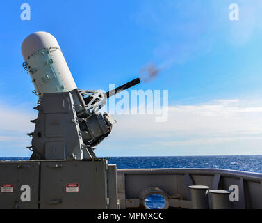ATLANTIC OCEAN (April 4, 2017) – A close-in weapons system (CIWS) is fired remotely on the fantail of the amphibious assault ship USS Iwo Jima (LHD 7). Iwo Jima is underway conducting a series of qualifications and certifications as part of the basic phase of training in preparation for future operations and deployments. (U.S. Navy photo by Mass Communication Specialist Seaman Daniel C. Coxwest/Released) - Stock Photo