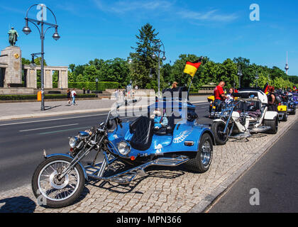 Berlin Mitte, Parked three wheeler motor bikes. Blue Motor bike with soft toy mascots at  Bikers Demo.                                                 - Stock Photo