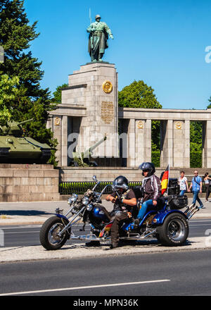 Berlin Mitte, Motor biker and passenger on three wheeler in front of Soviet War memorial. Hundreds of Bikers protest at the Brandenburg Gate for prote - Stock Photo