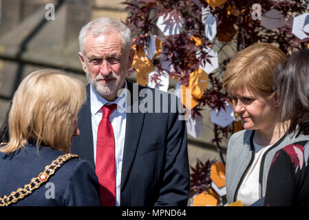 Jeremy Corbyn, Nicola Sturgeon, Lucy Powell MP and Vince Cable talk and stand in front of one of 22 'Trees of Hope'  outside Manchester Cathedral after the national service of commemoration remembering the victims of the Arena bomb attack in Manchester, Britain, on May 22, 2018. Prince William and British Prime Minister Theresa May joined other politicians, as well as family members of those killed, and first responders to the scene of the terror attack, whilst thousands of people gathered in Manchester Tuesday on the first anniversary of a terror attack in the city which left 22 people dead. - Stock Photo