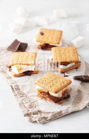 homemade marshmallow s'mores with chocolate on crackers - Stock Photo