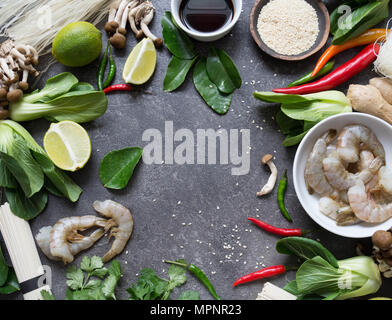 Various Asian ingredients on a dark background. Asian cooking ingredients.  Asian food concept. Open space. Top view - Stock Photo