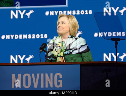 Long Island, USA. 23rd May, 2018. HILLARY CLINTON, with lips pursed, delivers Keynote Address during Day 1 of New York State Democratic Convention, held at Hofstra University on Long Island. Clinton, the former First Lady and NYS Senator, endorsed the re-election of Gov. A. Cuomo for a third term, and mentioned how Hofstra was the site of her first 2016 debate with Trump. Credit: Ann E Parry/Alamy Live News - Stock Photo