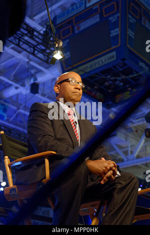 Long Island, USA. 23rd May, 2018. Reporter, sitting on media riser, tapes political news segment during Day 1 of New York State Democratic Convention, held at Hofstra University on Long Island. Credit: Ann E Parry/Alamy Live News - Stock Photo