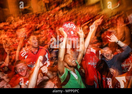 Washington, USA. 23rd May, 2018. Capitals fans celebrate on the streets of Washington, DC after wining game 7 for the Eastern Cup against the Tampa Bay lightning. Credit: SOPA Images Limited/Alamy Live News - Stock Photo
