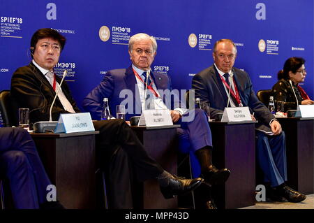 ST PETERSBURG, RUSSIA - MAY 24, 2018: The Secretary General of China Chamber of International Commerce (CCOIC) / Vice Chairman and Secretary General of the China International Economic and Trade Arbitration Commission (CIETAC), Yu Jianlong (L), the Secretary General of the Shanghai Cooperation Organisation, Rashid Alimov (2nd L), the President of the Chamber of Commerce and Industry of the Russian Federation, Sergei Katyrin (2nd R), and the Under-Secretary-General of the United Nations / Executive Secretary of the United Nations Economic and Social Commission for Asia and the Pacific (UNESCAP) - Stock Photo