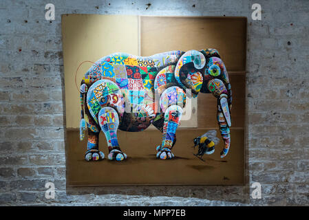London, UK.  24 May 2018. A painting of an African elephant at the preview of 'Missing' an exhibition by artist and environmentalist Louis Masai at the Crypt Gallery in Euston.  The exhibition features sculptures, installations and paintings depicting 20 endangered species across the world from the South African penguin to the humble bumble bee.  The show runs 25 to 27 May 2018.  Credit: Stephen Chung / Alamy Live News - Stock Photo