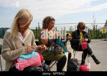 Preston, Lancashire, UK. 24th May, 2018. Three Anti- Frack Protestors Affectionately known as ''Nanas'' knit at the gates of the Fracking company ''Cuadrilla's'' Frack site during a quiet day of continuing protests. Cuadrilla have applied for an extension and modification of an injunction to make protesting at their site illegal, prior to commencing full fracking operations within the next few weeks. Credit: Andrew Mccoy/SOPA Images/ZUMA Wire/Alamy Live News - Stock Photo