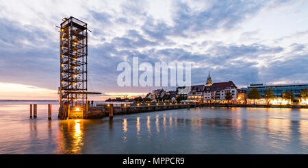 Germany, Baden-Wuerttemberg, Friedrichshafen, Lake Constance, city view and mole tower, harbour mole in the evening - Stock Photo