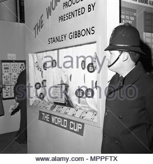 File photo dated 20/3/1966 of a policeman stands next to the display case in the Central Hall, Westminster, from which the World Cup was stolen. A London gangster and his brother were behind the notorious unsolved theft of the World Cup trophy just months before the 1966 tournament in England, it has been claimed. - Stock Photo
