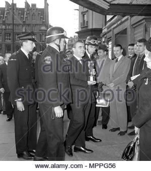 File photo dated 18/3/1966 of flanked by security men, the solid gold Jules Rimet Cup is carried into the National Stamp Exhibition (Stampex) at the Central Hall, Westminster, by Eric Allen, Sales Manager of Stanley Gibbons, the stamp dealers, on whose stand it is being shown. A London gangster and his brother were behind the notorious unsolved theft of the World Cup trophy just months before the 1966 tournament in England, it has been claimed. - Stock Photo