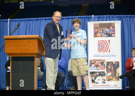 Jimmy Waddle, U.S. Army Corps of Engineers Nashville District Engineering and Construction Division chief, presents an award to Carson Fisher, 7th grade student from Robert E. Ellis Middle School in Hendersonville, Tenn., during the Science, Technology, Engineering and Mathematics Expo at Tennessee State University Gentry Center April 6, 2017. He was presented with a glass trophy and certificate for his project, a self-rising levee system. - Stock Photo
