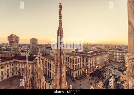 Italy, Lombardy, Milan, Milano Cathedral and Piazza del Duomo at sunset - Stock Photo
