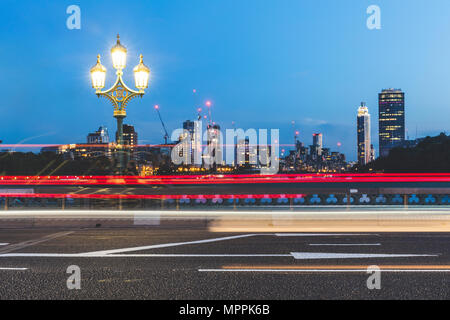 UK, London, traffic light trails on Westminster Bridge at dusk - Stock Photo