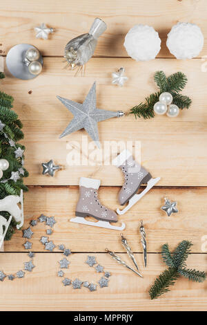 Christmas decoration items, real fir tree green, snow ball candles, skates, bird, Christmas baubles, vintage icicles, stars - Stock Photo