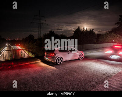 VW Golf 6 GTI on bridge No.1 - Stock Photo
