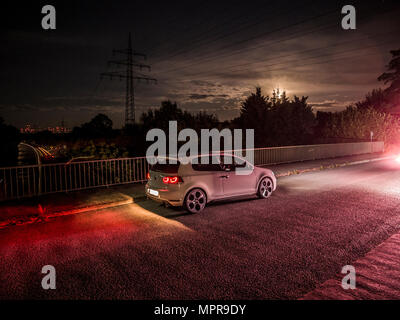VW Golf 6 GTI on bridge No.2 - Stock Photo