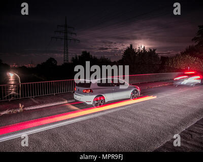 VW Golf 6 GTI on bridge No.3 - Stock Photo