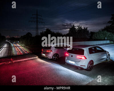 VW Golf GTI 6 & 7 Facelift on bridge - Stock Photo