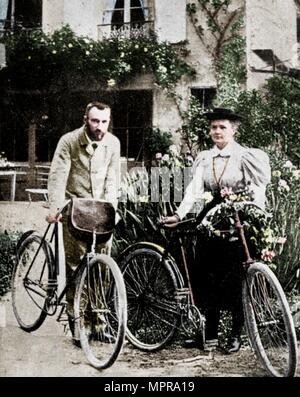 Pierre and Marie Curie, French physicists, preparing to go cycling. Artist: Unknown. - Stock Photo
