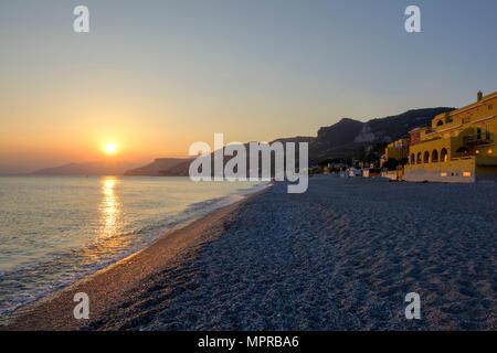 Italy, Liguria, Riviera di Ponente, Finale Ligure, sunset at beach Varigotti - Stock Photo