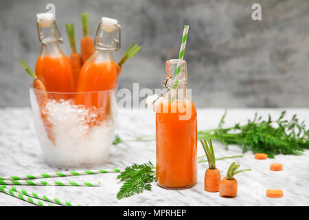 Refreshing carrot juice on marble - Stock Photo