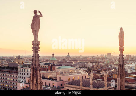 Italy, Lombardy, Milan, statues on the Milan Cathedral at the sunset - Stock Photo